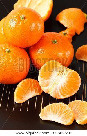 Healthy Mandarin Oranges On Black Background