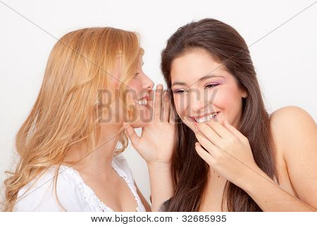 teens whispering and gossiping