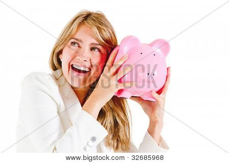 Business woman shaking a piggybank - isolated over a white background