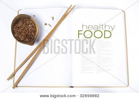 uncooked rice,  chopsticks and opened notebook(with easy removable sample text)