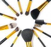 Make-up Brushes set over white background. Various Professional makeup brush on white in studio. Mak poster