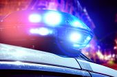 Blue And Red Light Flasher Of A Patrol Police Car At Night. Police Force Department In Full Activity poster