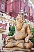 stock photo of laxmi  - Statue of man in meditation pose with mala in Laxmi Narayan temple or birla madir in new delhi India - JPG
