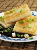 foto of taro corms  - Taro cakes are a common dim sum dish in Chinese culture - JPG