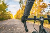 Biking first person view of bike cyclist POV showing hands and handlebar on road bicycle riding on o poster