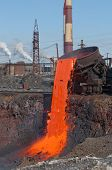stock photo of slag  - The molten steel is poured into the slag dump - JPG