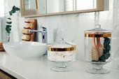 Jars With Cotton Pads And Hairbrushes On Bathroom Countertop poster