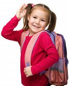 stock photo of bye  - Portrait of a cute little schoolgirl with backpack - JPG