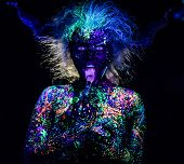 The Girl In The Image Of The Devil, Contact Lenses And Horns. Woman Paints Her Tongue In Ultraviolet poster