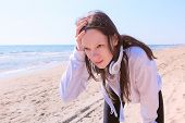 Girl Brunette Have A Break On Running Training At Sea Sand Beach. She Stops Jogging To Catch A Breat poster