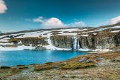 Road Aurlandsfjellet, Norway. Waterfall Flotvatnet In Spring Snowy Landscape. Scenic Route Road In S poster
