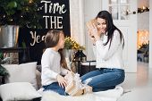 Merry Christmas And Happy Holidays. Cheerful Mom And Her Cute Daughter Girl Opening A Christmas Pres poster