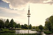 Sending And Receiving Waves. Tower Or Radio Mast. Tv Tower On Urban Landscape. Tall Tower Supporting poster
