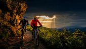 Cycling, mountain biker couple on epic cycle trail in autumn forest. Mountain biking in autumn lands poster