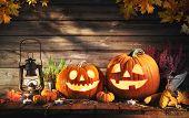 Halloween pumpkin head jack-o-lantern on wooden background poster
