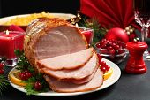 Delicious Christmas Ham Served With Garnish On Dark Table poster