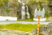Equipment Of Viking Or Barbarian Warrior Outdoor On Nature. Viking Axe Against Norwegian Nature. Tou poster