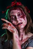 Close-up Portrait Of Horrible Zombie Woman With Wounds. Horror. Halloween Poster. The Shouting Femal poster