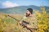 Bearded Hunter Spend Leisure Hunting. Focus And Concentration Of Experienced Hunter. Hunting And Tra poster