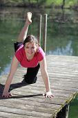 stock photo of youg  - youg girl is doing fitness in nature - JPG