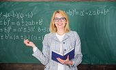 Effective Teaching Involve Acquiring Relevant Knowledge. Woman Teaching Near Chalkboard In Classroom poster