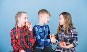 Eat Fruit And Be Healthy. Promoting Healthy Nutrition. Boy And Girls Friends Eat Apple. Teens With H poster