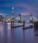 City Skyline At Sunset With London Tower Bridge And The Shard On Thames River In England poster