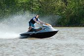 pic of waverunner  - A young man riding a jetski on the river - JPG