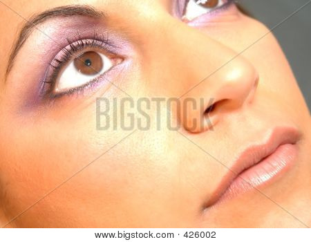 make up glow,brown eyes and purple eye shadow