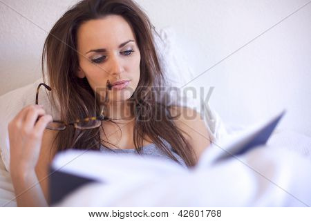 Brunette Woman Engrossed In Her Reading