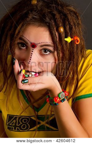 Young Beautiful Girl With Dreadlocks Holds Pill In The Palm