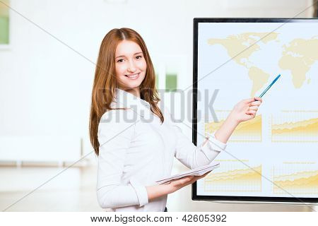young business woman shows map of world