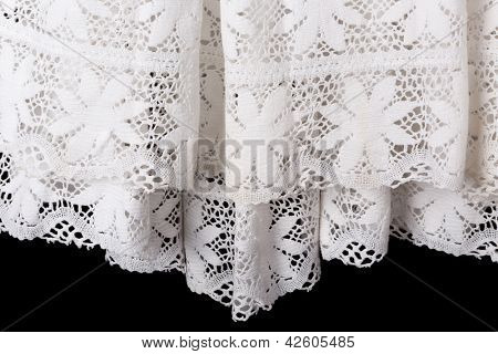 Detail of the white lace edge of a catholic priest surplice