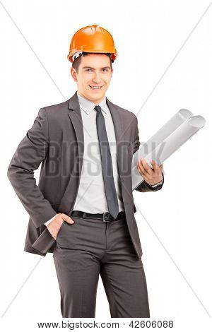 Young male engineer with helmet holding blueprints, isolated on white background