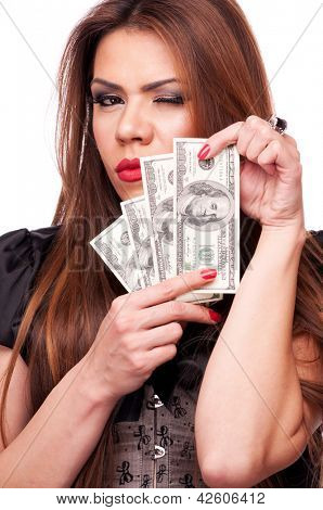 Beautiful brunette holding American Dollar bills and winking