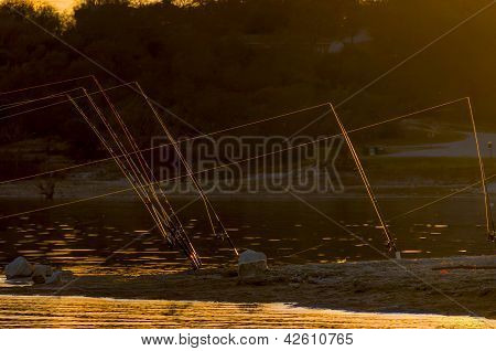 Fishing Poles At Sunset
