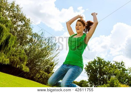 Euphoric Girl Jumping In Park.