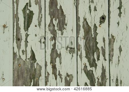 green peeling wooden wall