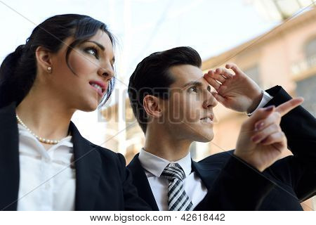 Attractive Business People Looking At Something Interesting. Couple Working.