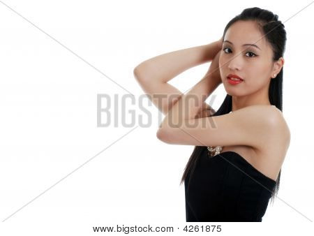 Asian Lady Fixing Her Hair