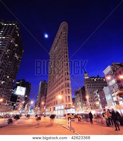 NEW YORK CITY, NY - DEC 30: Flatiron Building at night on March 30, 2011 in New York City. Flatiron building designed by Chicago's Daniel Burnham was designated a New York City landmark in 1966.