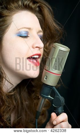 Pretty Woman Singing Into Microphone