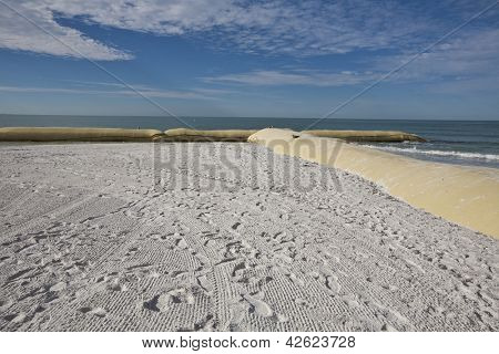 Giant sandbags help prevent beach erosion alon St. Pete's beach in Florida