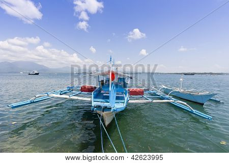 Outrigger boat moored at wharf, Palawan, Philippines