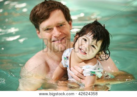 Father And Toddler Boy Swimming