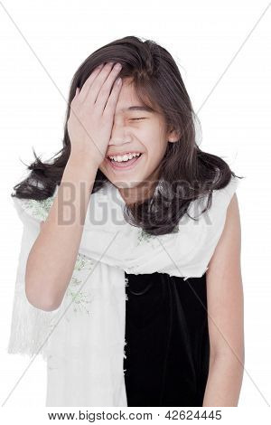 Young Girl Slapping Herself On The Head, Laughing