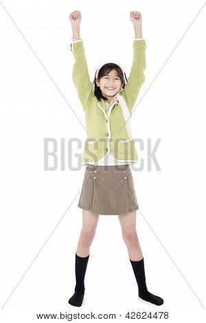 Girl In Green Sweater And Skort Standing With Arms Rasied, Happy