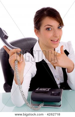 Front View Of Happy Businesswoman Pointing At Phone