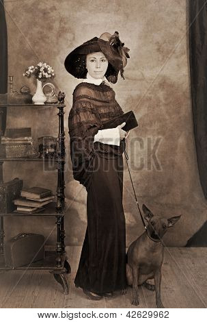 Sepia Portrait Of Woman With A Dog