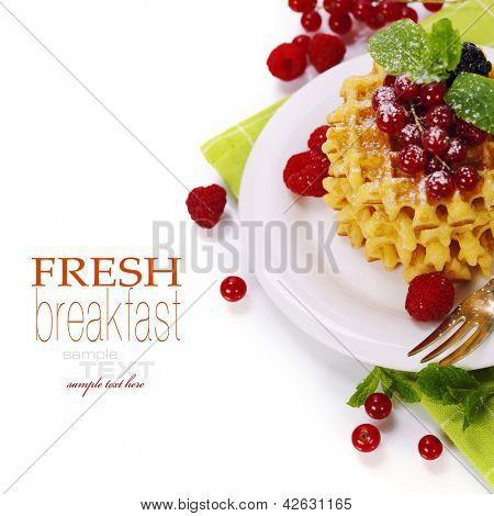 waffles with fresh berries over white (with easy removable sample text)